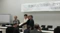 国会請願行動院内集会で古屋議員に署名簿を手渡す